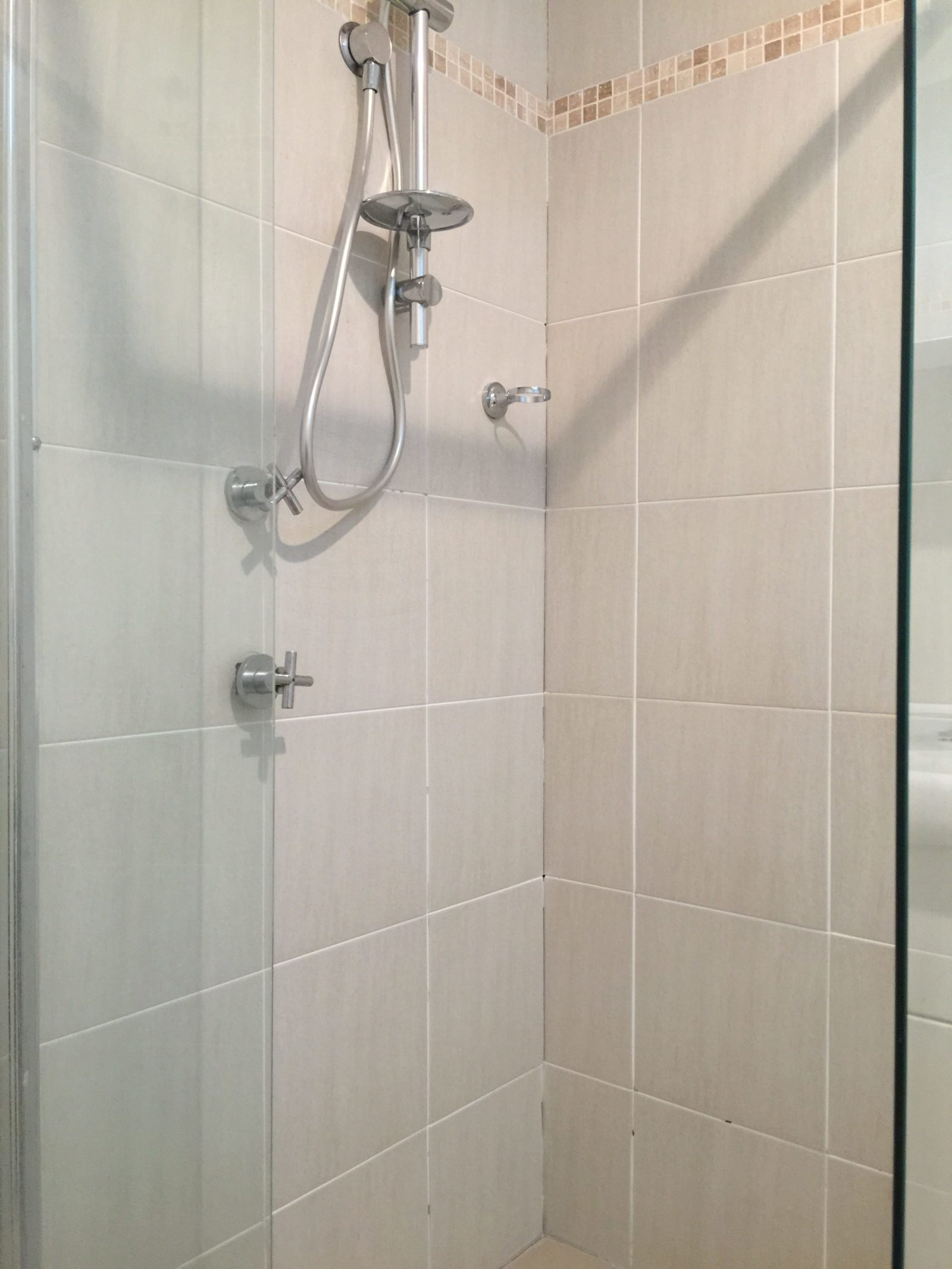 shower with missing wall grout and floor grout causing shower leaks